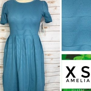 XS Amelia solid blue textured material w/pockets